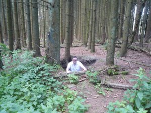 Exploring the foxholes in the wood